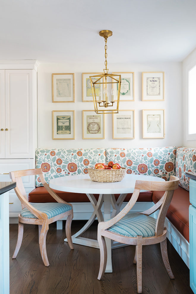 breakfast nook with banquette seating and brass pendant light
