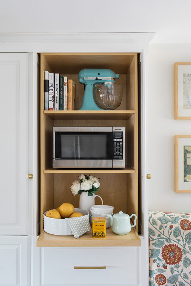 breakfast nook with pantry cabinet