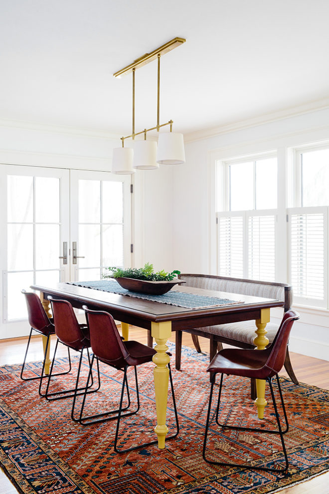 modern farmhouse dining room with vintage rug