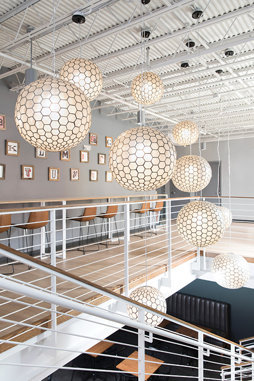 west-elm-orb-pendants-atrium-office-loft-ceilings
